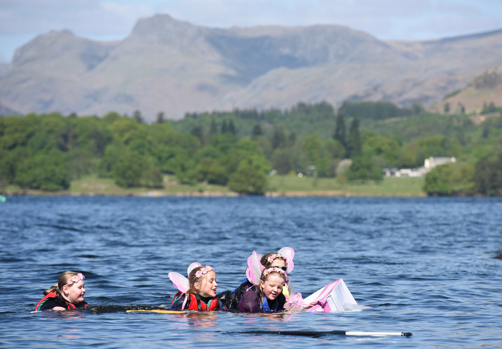 Dated: 15/05/2016 This is the bizarre sight of boats made entirely of CARDBOARD sailing across Lake Windermere against the scenic backdrop of the majestic fells. FAO: Benjamin Berry - English Lakes