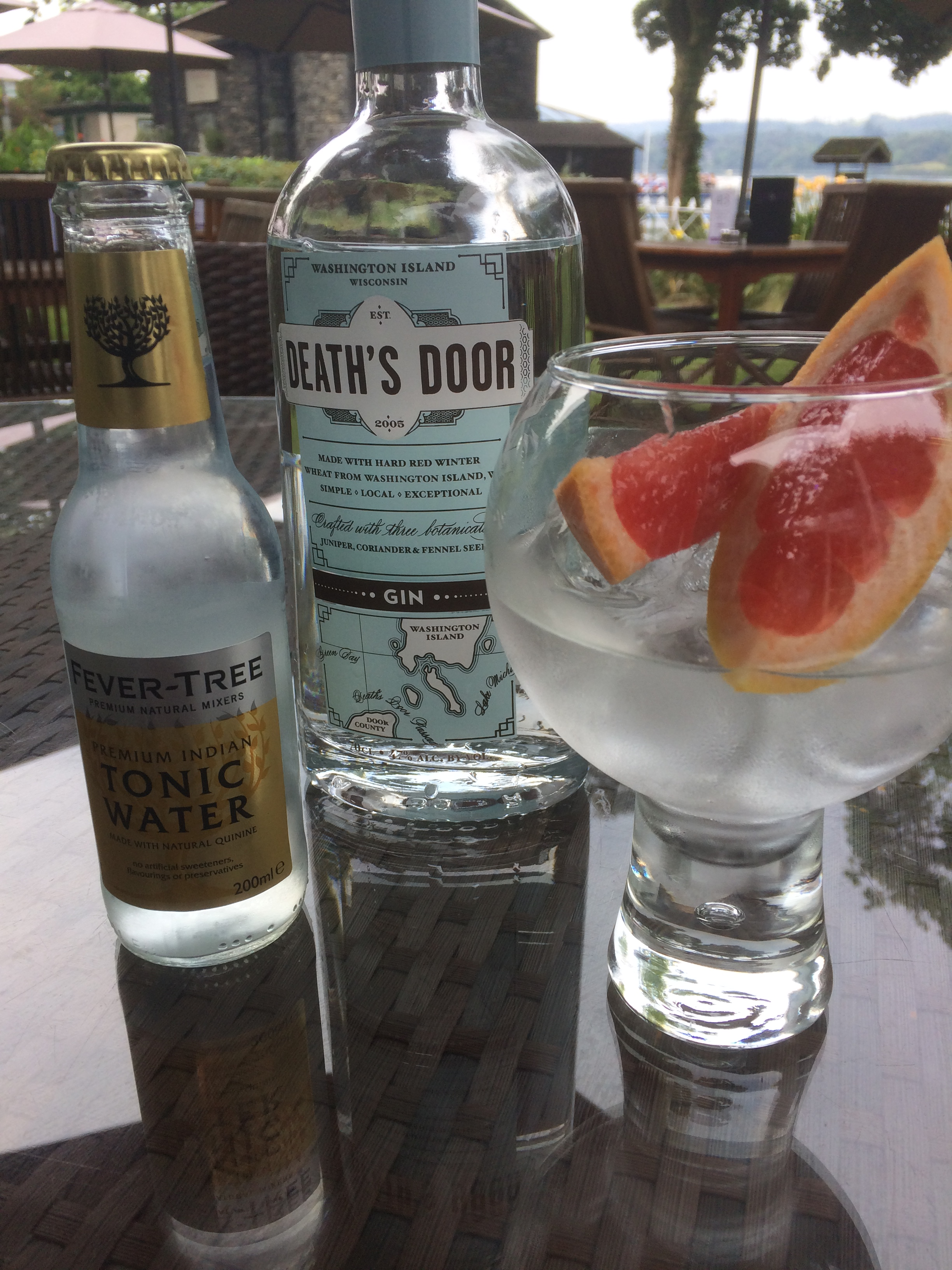 A refreshing gin and tonic served in the garden at Waterhead overlooking the lake