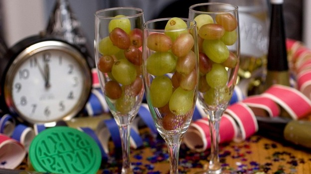Champagne flutes filled with grapes.